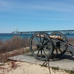 Fort Michilimackinac lakeside cannon with the Mackinac Bridge behind